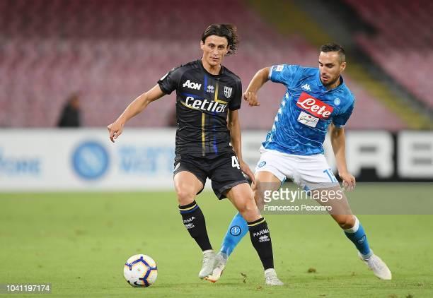 Nikola Maksimovic of SSC Napoli vies Roberto Inglese of Parma Calcio during the serie A match between SSC Napoli and Parma Calcio at Stadio San Paolo...