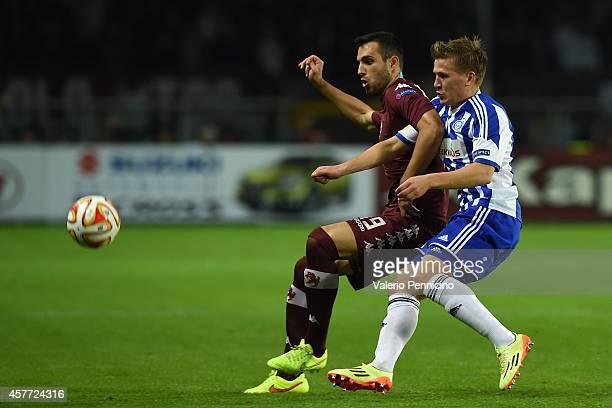 Nikola Maksimovic of Torino FC competes with Robin Lod of HJK Helsinki during the UEFA Europa League group B match between Torino FC and HJK Helsinki...