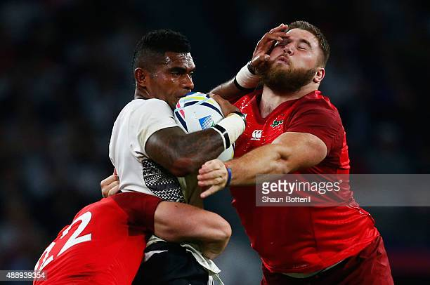 Nikola Matawalu of Fiji hands off Kieran Brookes of England during the 2015 Rugby World Cup Pool A match between England and Fiji at Twickenham...