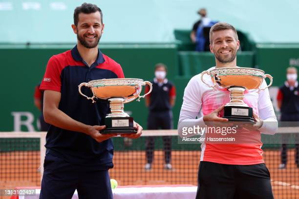 Nikola Mektic and Mate Pavic of Croatia celebrate with the trophy after winning the Mens Doubles Final match against Daniel Evans and Neal Skupski of...