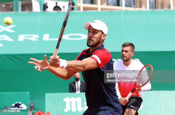 Nikola Mektic and Mate Pavic of Croatia in action during their Mens Doubles Final match against Daniel Evans and Neal Skupski of Great Britain on day...