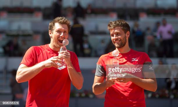 Nikola Mektic of Croatia and Alexander Peya of Austria celebrate with their trophies after winning the doubles final against Bob Bryan and Mike Bryan...