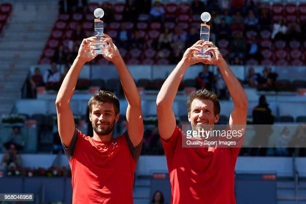 Nikola Mektic of Croatia and Alexander Peya of Austria with their trophies after winning his match against Bob Bryan of the United States and Mike...