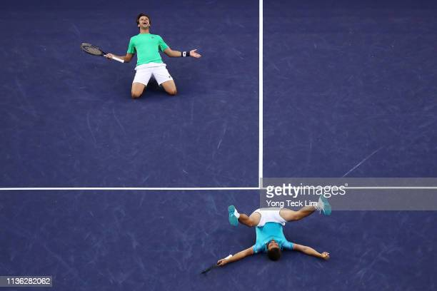 Nikola Mektic of Croatia and Horacio Zeballos of Argentina celebrate their men's doubles final match victory against Lukasz Kubot of Poland and...