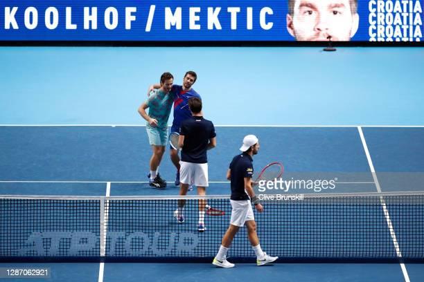 Nikola Mektic of Croatia and partner Wesley Koolhof of Netherlands celebrate after winning match point during the doubles final match against Jurgen...