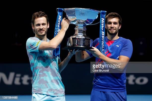 Nikola Mektic of Croatia and partner Wesley Koolhof of Netherlands celebrate with the trophy after winning the doubles final match against Jurgen...
