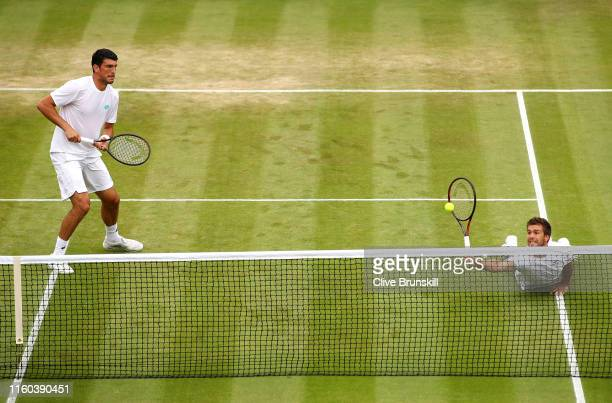 Nikola Mektic of Croatia, partner of Franko Skugor of Croatia dives to play a forehand at the net in their Men's Doubles second round match against...