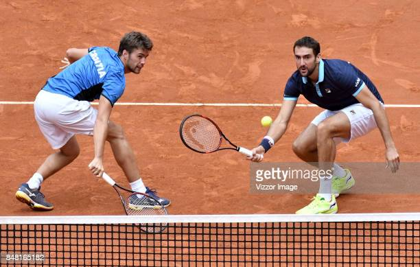 Nikola Metick and Marin Cilic of Croatia in action during a doubles match against Santiago Giraldo of Colombia as part of Davis Cup at La Santamaria...