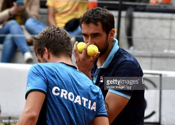 Nikola Metick and Marin Cilic of Croatia talk during a doubles match against Santiago Giraldo of Colombia as part of Davis Cup at La Santamaria Ring...
