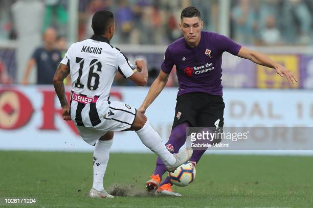 Nikola Milankovic of ACF Fiorentina battles for the ball with Darwin Machis of Udinese Calcio during the serie A match between ACF Fiorentina and...