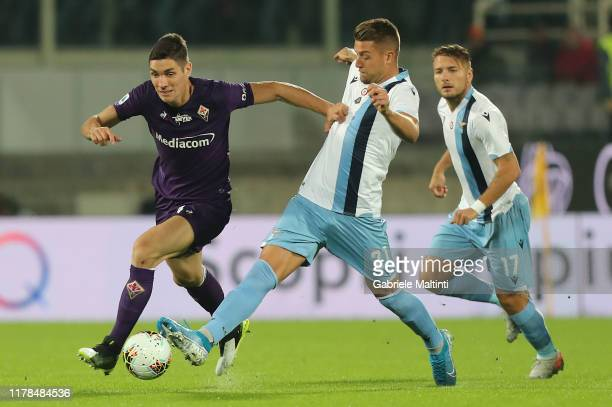 Nikola Milenkovic of ACF Fiorentina battles for the ball with Luis Alberto of SS Lazio during the Serie A match between ACF Fiorentina and SS Lazio...