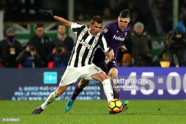 Nikola Milenkovic of ACF Fiorentina battles for the ball with Mario Mandzukic of Juventus during the serie A match between ACF Fiorentina and...
