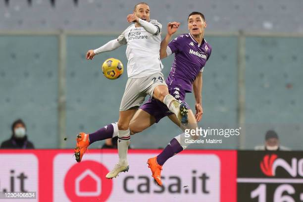Nikola Milenkovic of ACF Fiorentina battles for the ball with Rodrigo Palacio of Bologna FC during the Serie A match between ACF Fiorentina and...