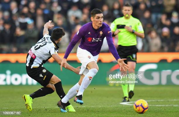 Nikola Milenkovic of ACF Fiorentina competes for the ball with Ignacio Pussetto of Udinese Calcio during the Serie A match between Udinese and ACF...