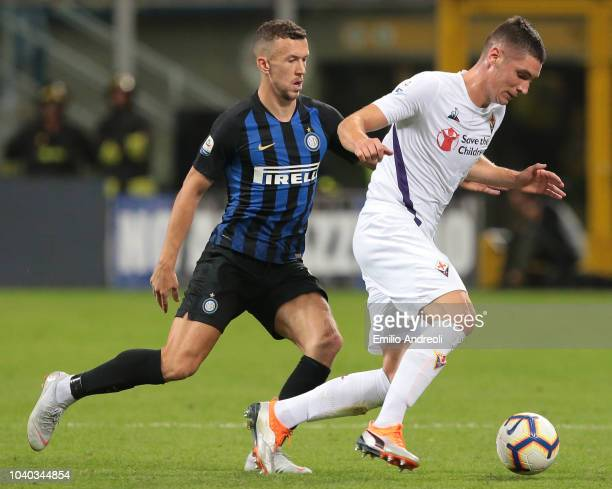 Nikola Milenkovic of ACF Fiorentina is challenged by Ivan Perisic of FC Internazionale during the Serie A match between FC Internazionale and ACF...