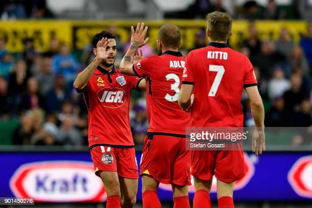 Nikola Mileusnic congratulates Daniel Adlung of Adelaide after he scores a goal during the round 14 ALeague match between the Perth Glory and...