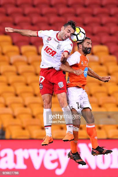 Nikola Mileusnic of Adelaide and Fahid Ben Khalfallah of the Roar challenge for the ball during the round 22 ALeague match between the Brisbane Roar...