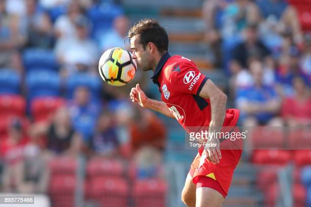 Nikola Mileusnic of Adelaide attempts to head the ball during the round 11 ALeague match between the Newcastle Jets and the Adelaide United at...