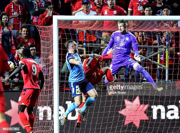 Nikola Mileusnic of Adelaide misses a goal chance saved by goal keeper Andrew Redmayne of Sydney FC by during the round nine ALeague match between...