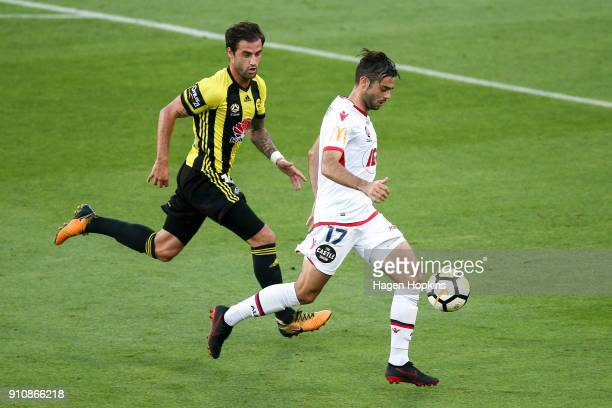 Nikola Mileusnic of Adelaide United and Tom Doyle of the Phoenix compete for the ball during the round 18 ALeague match between the Wellington...