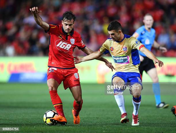 Nikola Mileusnic of Adelaide United competes with Benjamin Kantarovski of the Newcastle Jets during the round 24 ALeague match between Adelaide...