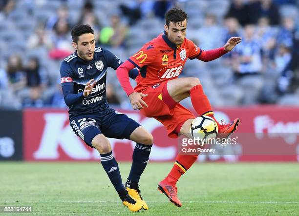 Nikola Mileusnic of Adelaide United controls the ball infront of Stefan Nigro of the Victory during the round 10 ALeague match between the Melbourne...
