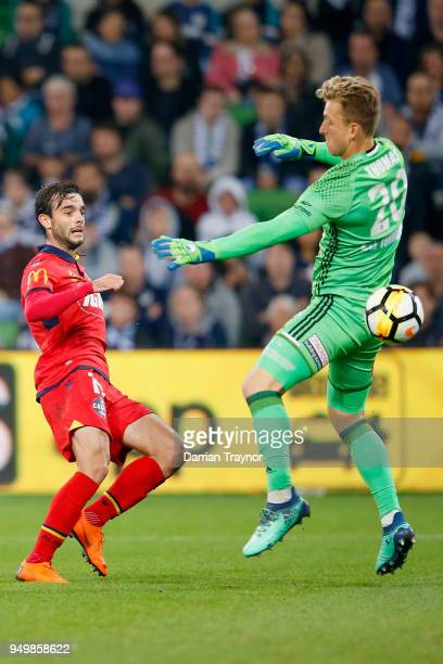 Nikola Mileusnic of Adelaide United gets a ball past Victory goalkeeper Lawrence Thomas to score during the ALeague Elimination Final match between...