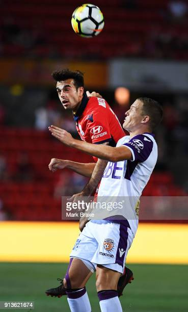 Nikola Mileusnic of Adelaide United heads over Shane Lowry of Perth Glory during the round 19 ALeague match between Adelaide United and the Perth...