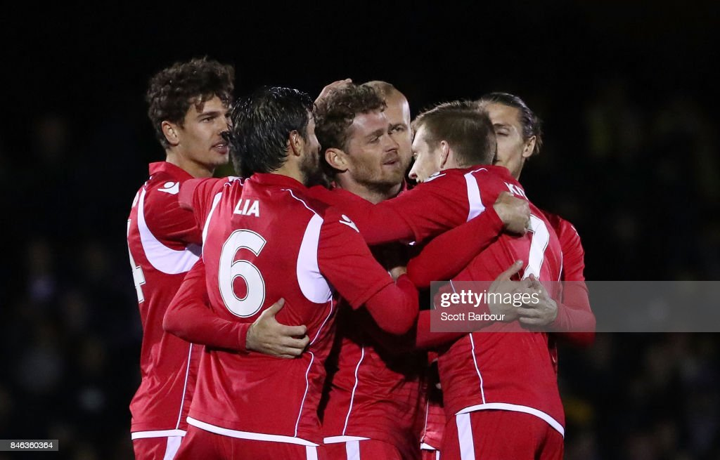 Nikola Mileusnic of Adelaide United is congratulated by his teammates after scoring a goal during the FFA Cup Quarter Final match between Heidelberg United FC and Adelaide United at Olympic Village on September 13, 2017 in Melbourne, Australia.