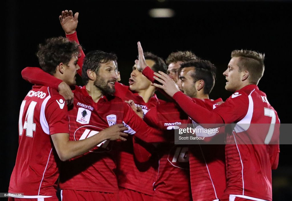 Nikola Mileusnic of Adelaide United is congratulated by his teammates after scoring his second goal during the FFA Cup Quarter Final match between Heidelberg United FC and Adelaide United at Olympic Village on September 13, 2017 in Melbourne, Australia.