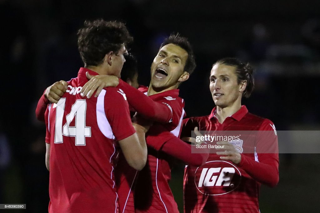 Nikola Mileusnic of Adelaide United is congratulated by his teammates after scoring his third goal during the FFA Cup Quarter Final match between Heidelberg United FC and Adelaide United at Olympic Village on September 13, 2017 in Melbourne, Australia.