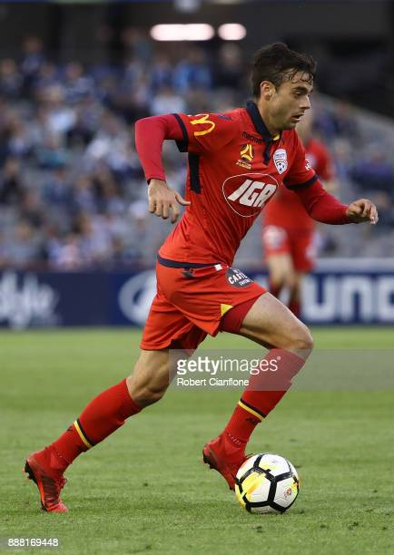 Nikola Mileusnic of Adelaide United runs with the ball during the round 10 ALeague match between the Melbourne Victory and Adelaide United at Etihad...
