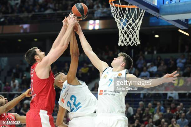 Nikola Milutinov #11 center of Olympiacos Piraeus and Tavares #22 center of Real Madrid and Luka Doncic #7 guard of Real Madrid during the 2017/2018...