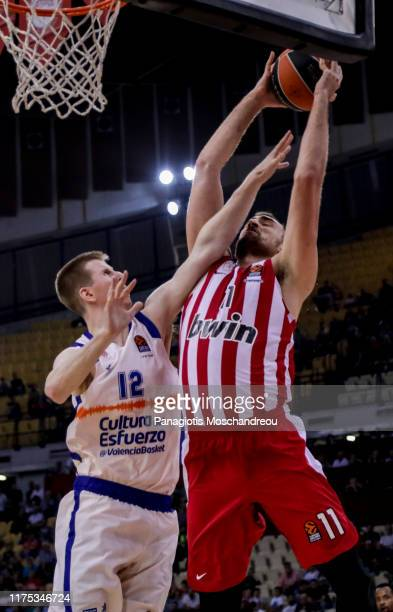 Nikola Milutinov, #11 of Olympiacos Piraeus competes with Brock Motum, #12 of Valencia Basket during the 2019/2020 Turkish Airlines EuroLeague...