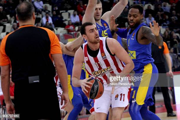 Nikola Milutinov #11 of Olympiacos Piraeus competes with Deshaun Thomas #1 of Maccabi Fox Tel Aviv during the 2017/2018 Turkish Airlines EuroLeague...