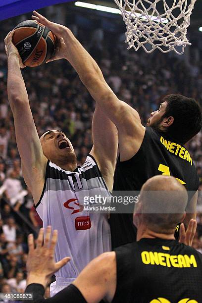 Nikola Milutinov #8 of Partizan mts Belgrade competes with Kostas Papanikolau #16 of FC Barcelona during the 20132014 Turkish Airlines Euroleague...