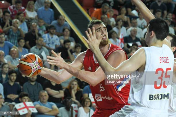 Nikola Milutinov of Serbia passes the ball during the FIBA Basketball World Cup Qualifier match between Georgia and Serbia at Tbilisi Sports Palace...