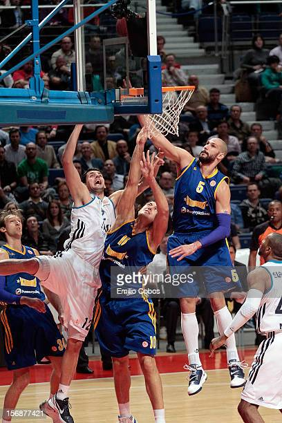 Nikola Mirotic #12 of Real Madrid competes with in action during the 20122013 Turkish Airlines Euroleague Regular Season Game Day 7 between Real...