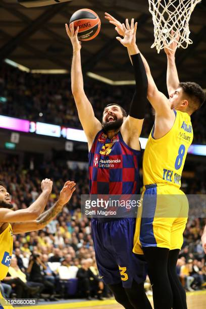 Nikola Mirotic #33 of FC Barcelona competes with Deni Avdija #8 of Maccabi Fox Tel Aviv during the 2019/2020 Turkish Airlines EuroLeague Regular...