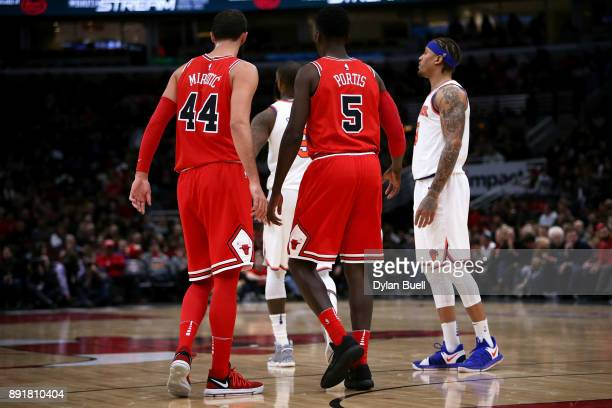 Nikola Mirotic and Bobby Portis of the Chicago Bulls walk across the court in the first quarter against the New York Knicks at the United Center on...