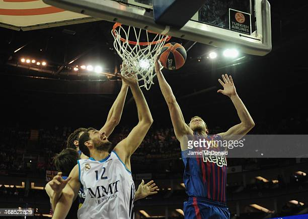 Nikola Mirotic of Real Madrid tussles with Joe Ingles of FC Barcelona during the Turkish Airlines EuroLeague Final Four semi final game between FC...