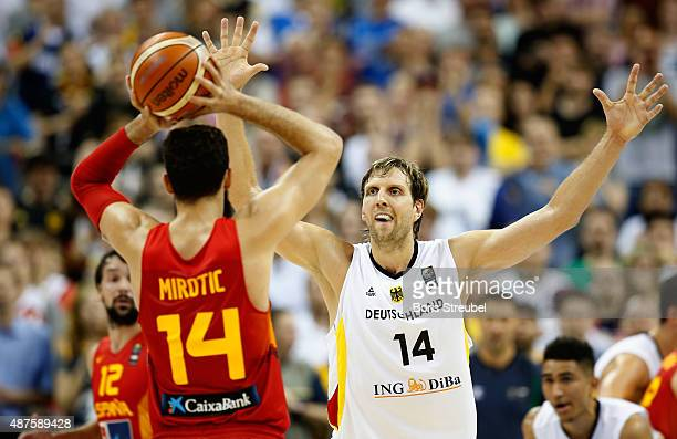 Nikola Mirotic of Spain is to blocked by Dirk Nowitzki of Germany during the FIBA EuroBasket 2015 Group B basketball match between Germany and Spain...