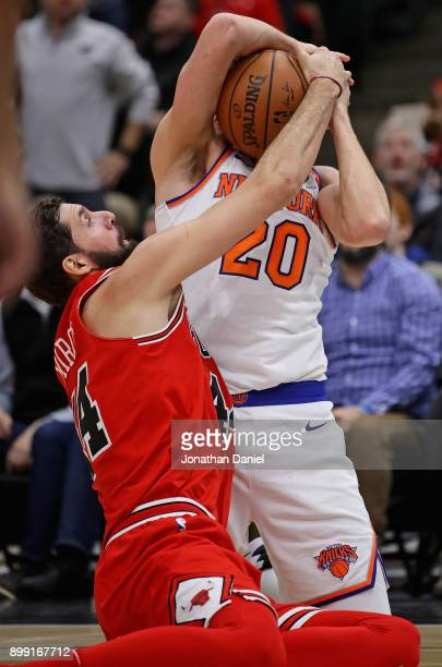 Nikola Mirotic of the Chicago Bulls and Doug McDermott of the New York Knicks battle for a loose ball at the United Center on December 27 2017 in...
