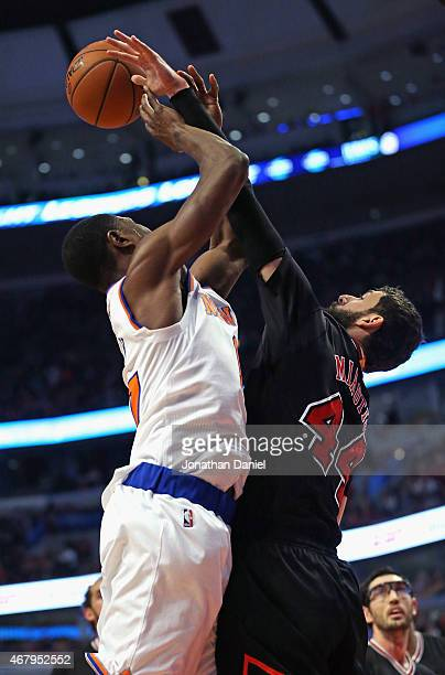 Nikola Mirotic of the Chicago Bulls blocks a shot by Cleanthony Early of the New York Knicks at the United Center on March 28 2015 in Chicago...