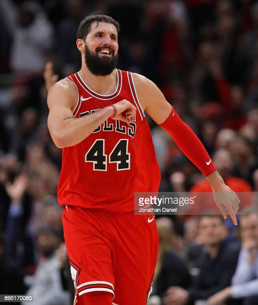 Nikola Mirotic of the Chicago Bulls celebrates as he runs down the court after hitting a 3 point shot late in the game against the Philadelphia 76ers...