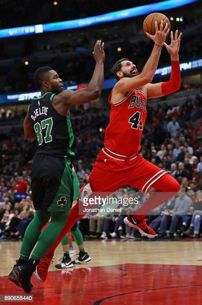 Nikola Mirotic of the Chicago Bulls drives past Semi Ojeleye of the Boston Celtics on his way to a gamehigh 24 points at the United Center on...