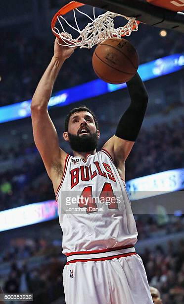 Nikola Mirotic of the Chicago Bulls dunks against the Phoenix Suns at the United Center on December 7 2015 in Chicago Illinois NOTE TO USER User...