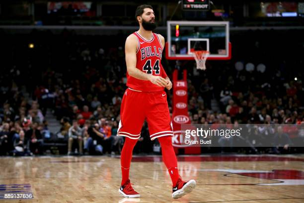 Nikola Mirotic of the Chicago Bulls enters the game in the first quarter against the New York Knicks at the United Center on December 9 2017 in...