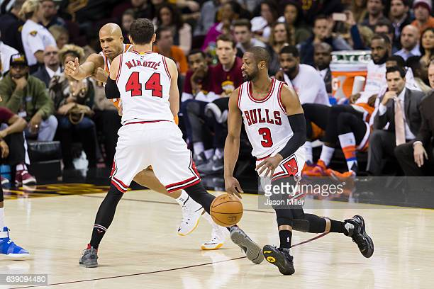 Nikola Mirotic of the Chicago Bulls guards Richard Jefferson of the Cleveland Cavaliers as Dwyane Wade of the Chicago Bulls drives into the paint...