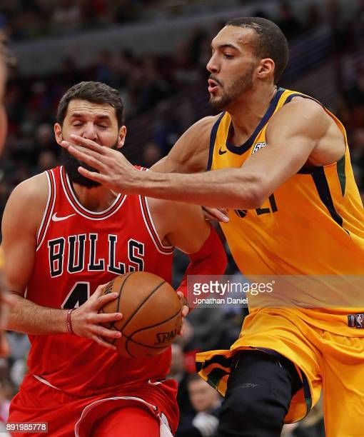 Nikola Mirotic of the Chicago Bulls is smacked in the face by Rudy Gobert of the Utah Jazz as he drives to the basket at the United Center on...